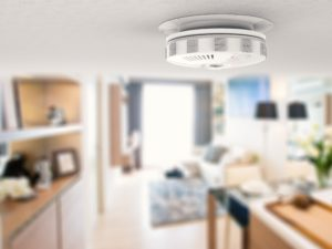 smoke detector on the ceiling in a house